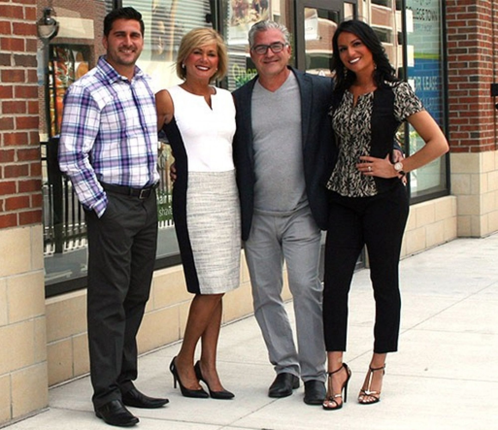 Photo of Spitale family in front of thei salon